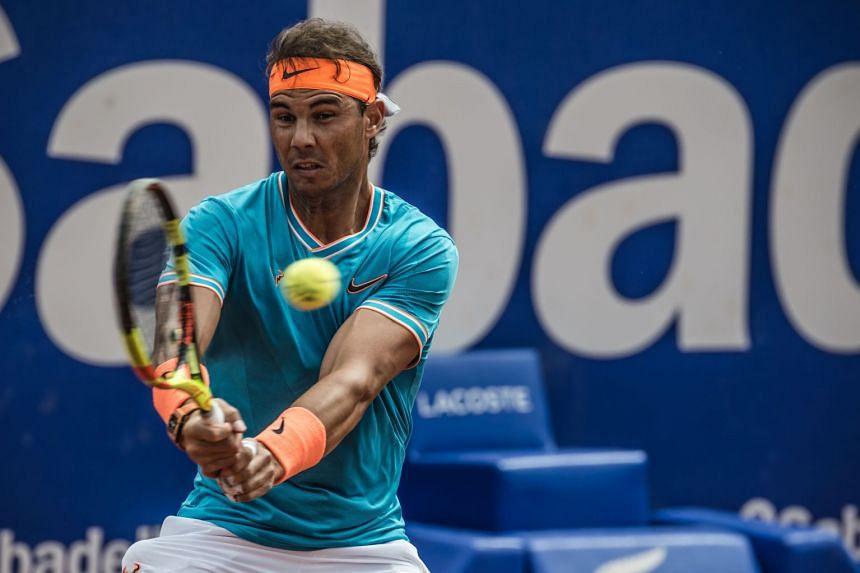 Nadal in action against compatriot David Ferrer.