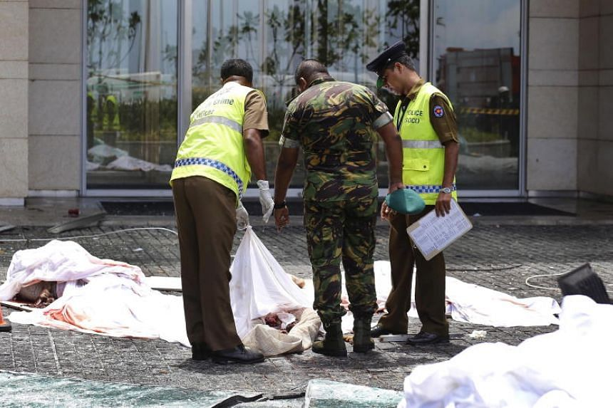 Police and security personnel inspecting remains of victims after a blast hit the Shangri-La hotel in Colombo. Radical Muslim preacher Zaharan Hashim is believed to be one of the two suicide bombers who targeted the hotel.