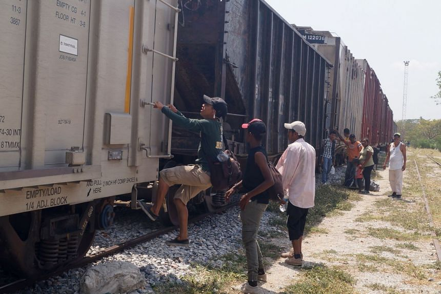 Central Americans board The Beast in Mexico.