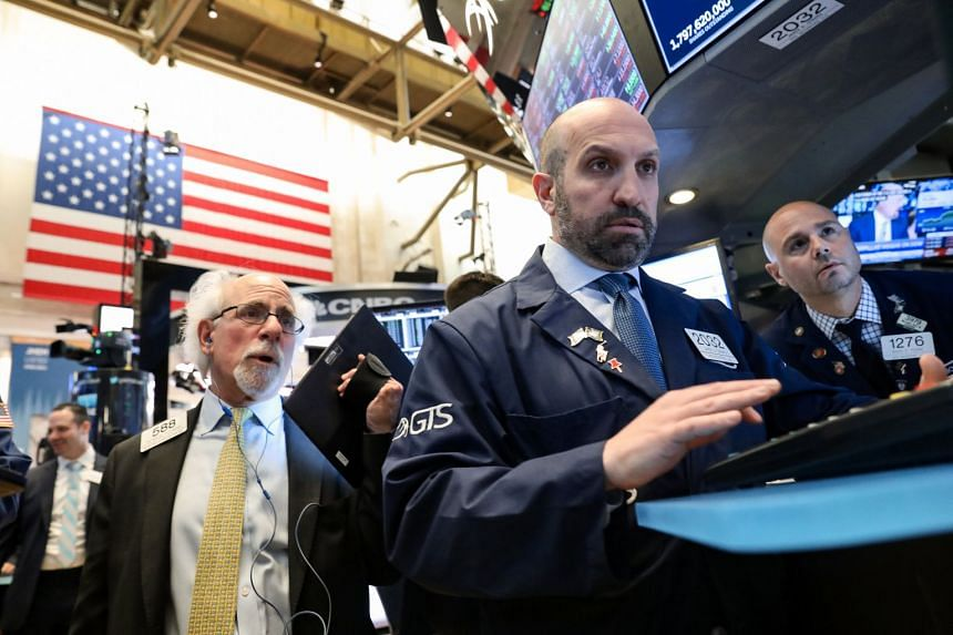 Traders work on the floor at the New York Stock Exchange, April 24, 2019.