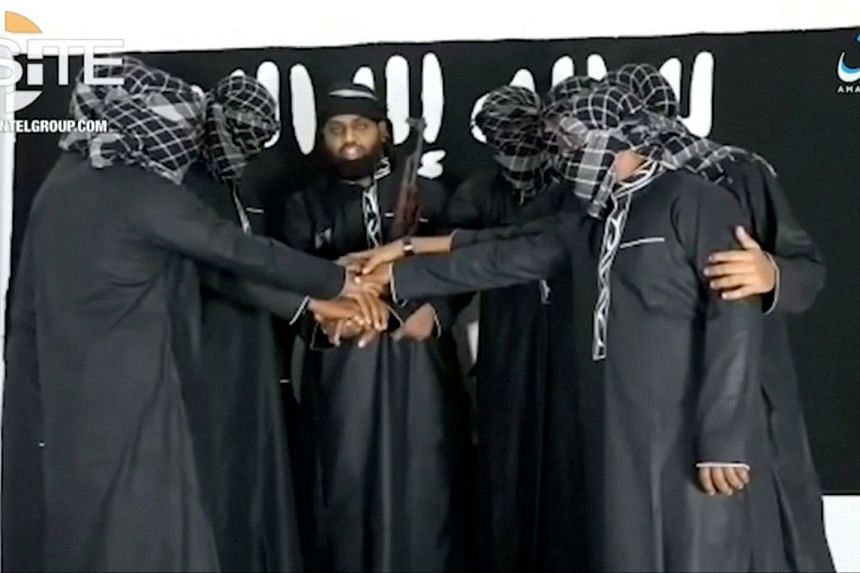 Mohamed Zahran (face uncovered) is seen with a group of men purported to be the Sri Lanka bomb attackers at an unknown location in a still image taken from video.