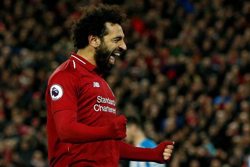 Liverpool's Mohamed Salah celebrates scoring their fifth goal.