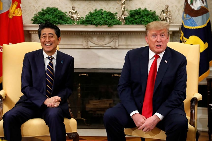 Trump meets Abe (left) in the Oval Office at the White House in Washington.