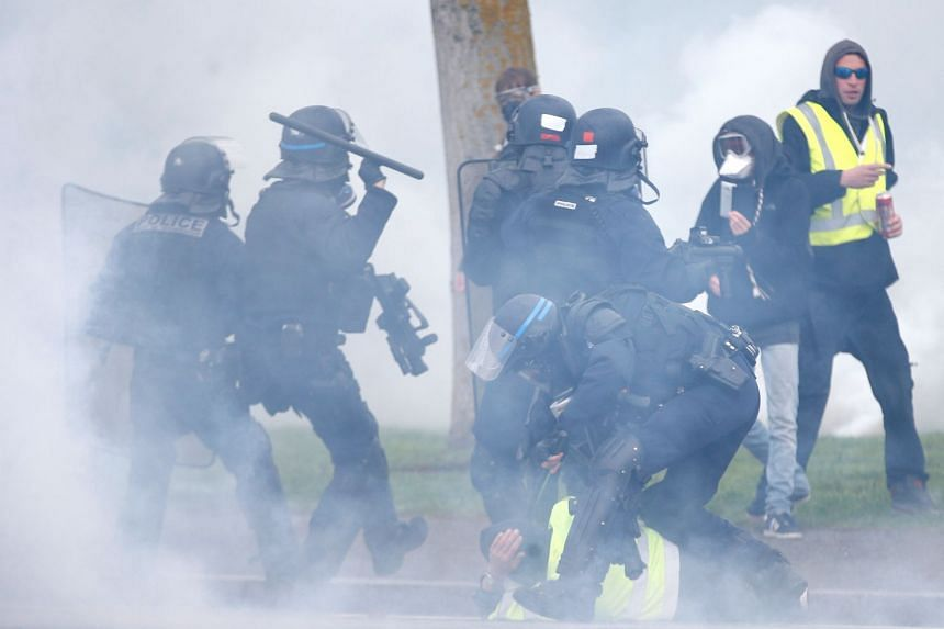 Riot police detain protesters as they clash in Strasbourg.