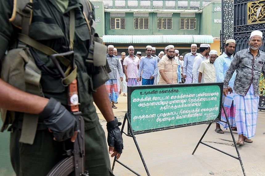 Security personnel standing outside Mohideen Meththai Grand Jumma Mosque in the town of Kattankudy, Sri Lanka, yesterday.