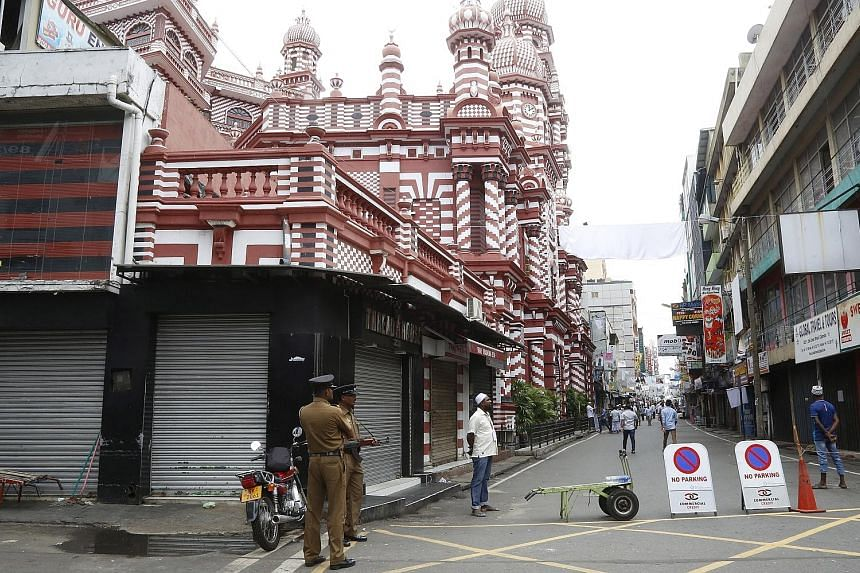 Sri Lankan security troops standing guard at Jami Ul-Alfar mosque in Colombo yesterday. Worshippers were searched before entering and security forces cordoned off the surrounding blocks. Fears of retaliatory sectarian violence have already caused Mus