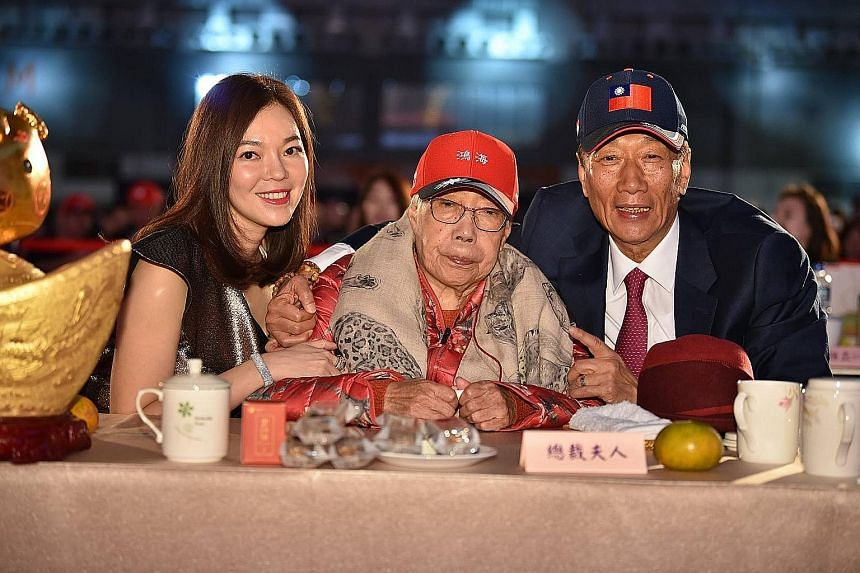 """Mr Terry Gou with his wife and his mother. When asked by reporters for his reaction to his wife's departure, Mr Gou said """"the harem should not meddle in politics"""", sparking backlashfrom the public."""