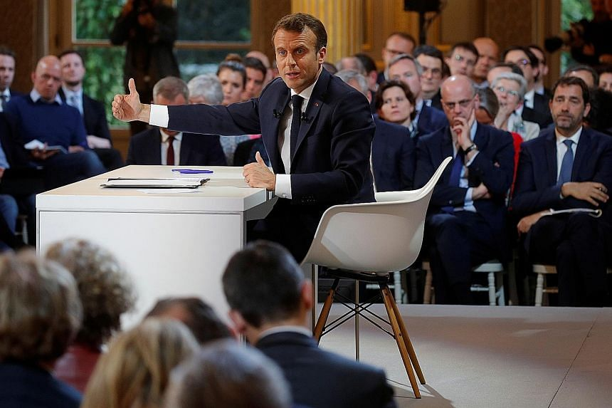 "French President Emmanuel Macron at a news conference to unveil his policy response to the ""yellow vest"" protests. He has offered €5 billion (S$7.6 billion) of cuts to income tax and has promised education reforms."