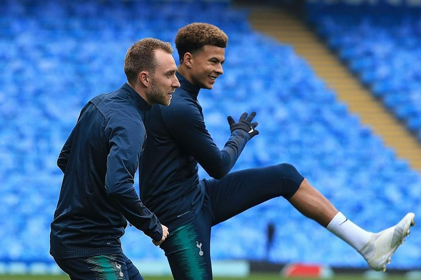 Tottenham's Danish midfielder Christian Eriksen (left, with Dele Alli) boosted Spurs' top-four ambitions with a late winner against Brighton on Tuesday.