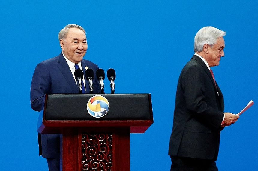 Former Kazakhstan president Nursultan Nazarbayev (left) and Chilean President Sebastian Pinera at the opening ceremony of the second Belt and Road Forum in Beijing yesterday.