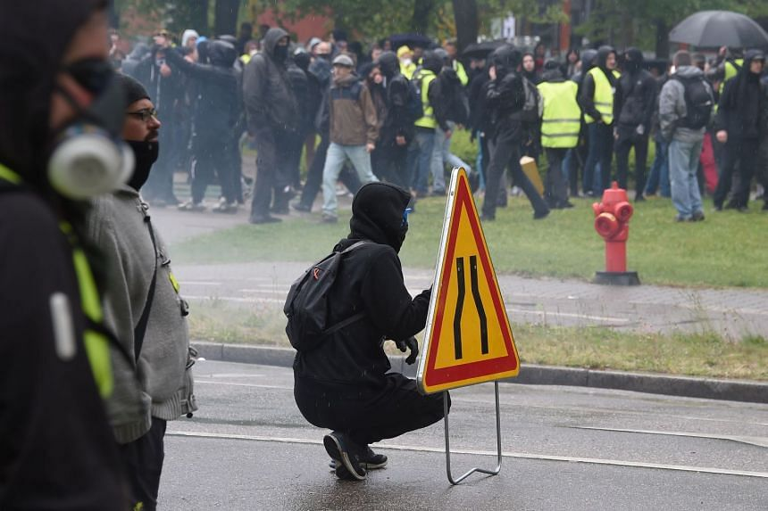 Demonstrators clash with riot police in Strasbourg, eastern France.
