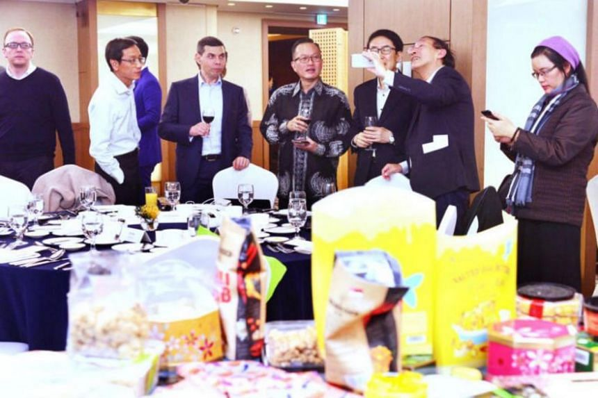 Asia News Network (ANN) members try out local food from around the region to mark the 20th anniversary of ANN, in Seoul on April 26, 2019.