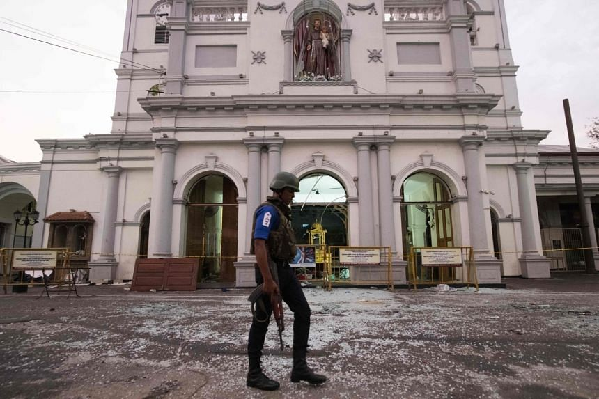 A soldier walks in front of St. Anthony's Shrine in Colombo, on April 26, 2019, following a series of bomb blasts targeting churches and luxury hotels on Easter Sunday in Sri Lanka.