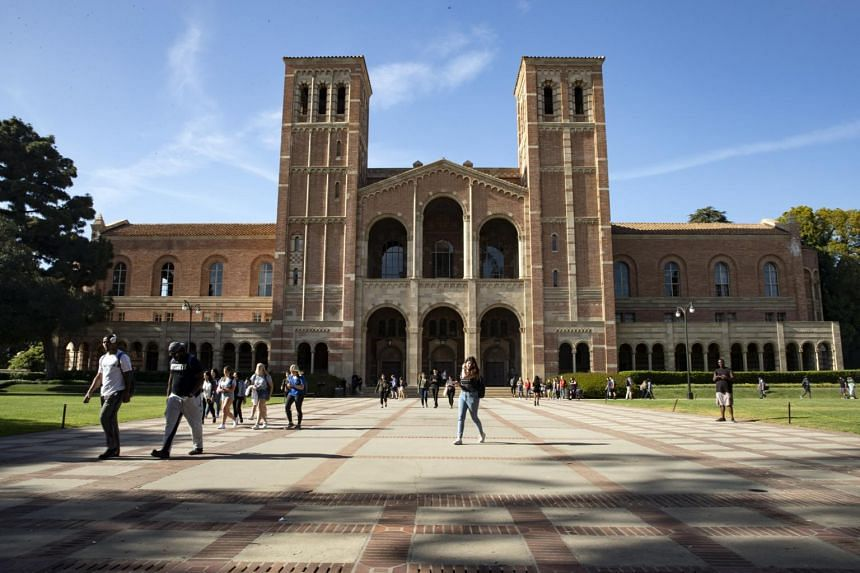 Students walk past at the University of California Los Angeles (UCLA). The quarantine period for the potential exposure at UCLA ends Tuesday, and at California State, Los Angeles on Thursday.