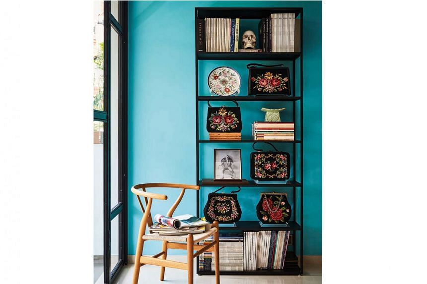 As the home owner's wife has a large handbag collection, he picked those with tapestry and vibrant prints for display in this nook.