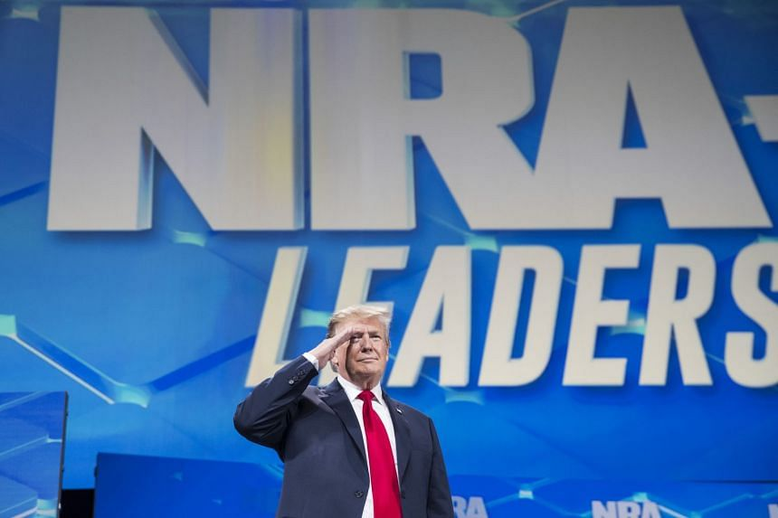 Trump takes the stage to address the National Rifle Association's annual conference.