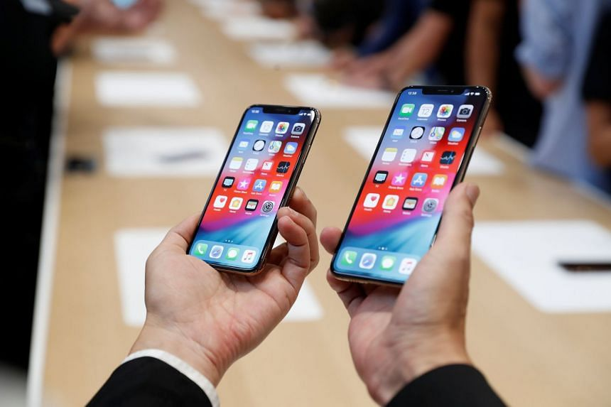 A man holds the Apple iPhone XS and XS Max during a product demonstration in 2018.