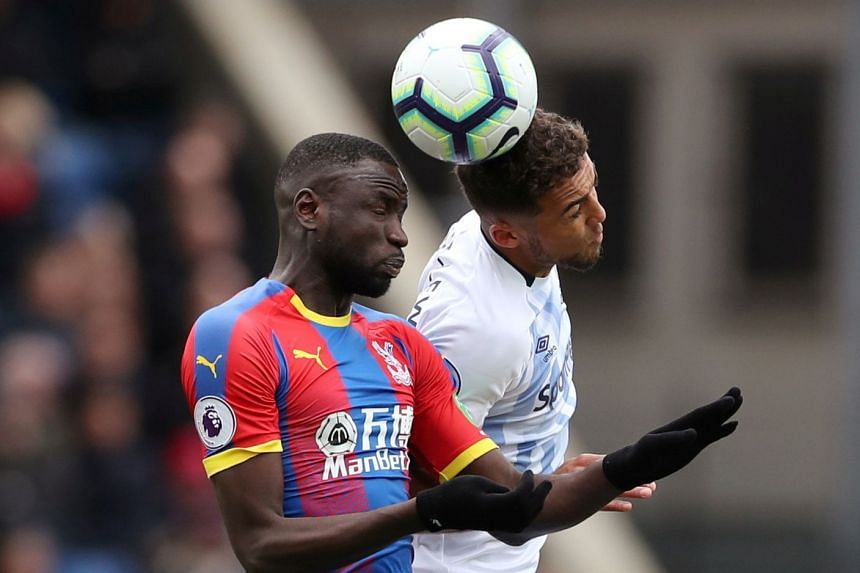 Crystal Palace's Cheikhou Kouyate in action with Everton's Dominic Calvert-Lewin.
