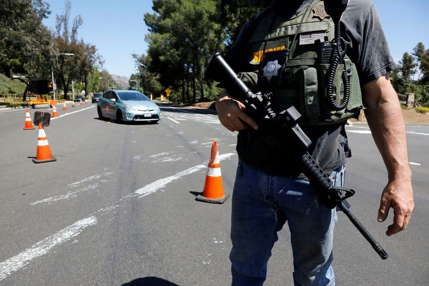 A San Diego County Sheriff's Deputy secures the scene of the shooting.