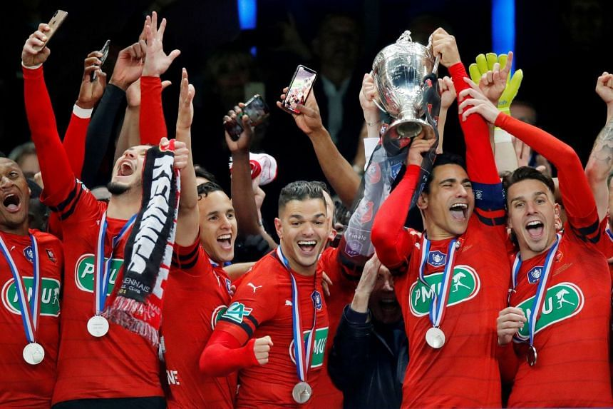 Stade Rennes' Hatem Ben Arfa celebrates with the trophy and team mates after winning the Coupe de France.