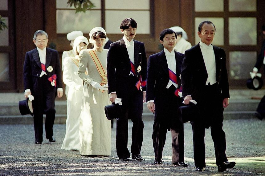 Crown Prince Naruhito (second from right) before the enthronement ceremony of his father, Emperor Akihito, on Nov 12, 1990. Walking behind him are his brother, Prince Akishino; Crown Princess Masako; and Princess Nori.