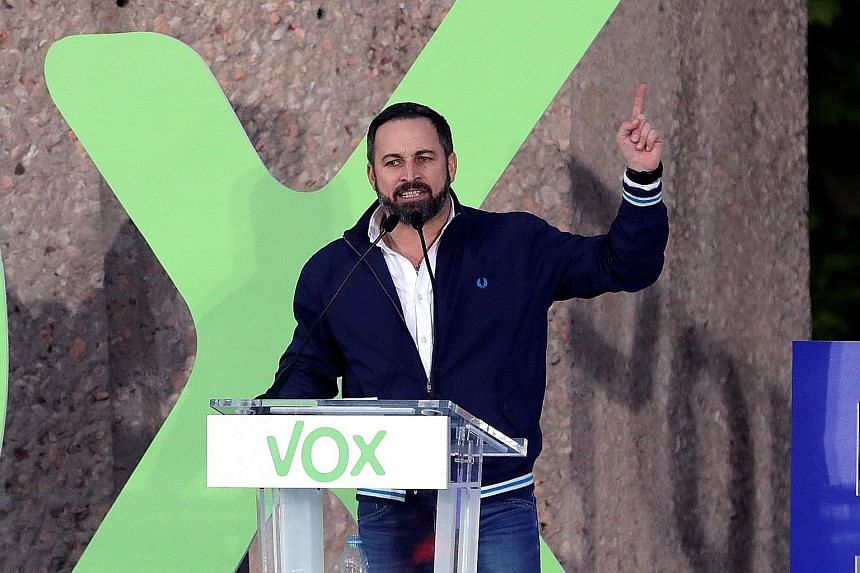Mr Santiago Abascal (left), leader of right-wing party Vox, delivering a speech in Madrid on Friday, ahead of Spain's general election today. His rivals include Spanish Prime Minister Pedro Sanchez (right) of the Socialist Party, seen here speaking i
