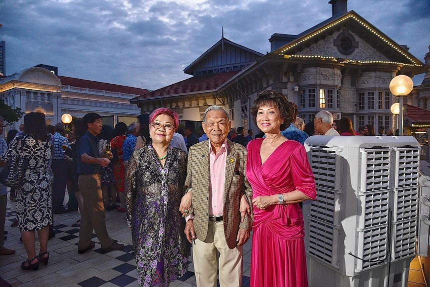 Former World War II bomber pilot Ho Weng Toh, 99, who flew for Malayan Airways, Malaysia-Singapore Airlines and Singapore Airlines, flanked by former air stewardesses Eunice Chua (left), 76, and Dolly Tan Soo Phin, 74, at the reunion at the Singapore