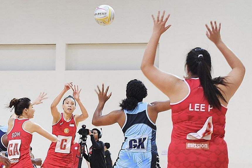 Vanessa Lee (centre) earned her 100th cap during yesterday's Test match against Fiji, who won 70-48 at the OCBC Arena. ST PHOTO: ALPHONSUS CHERN