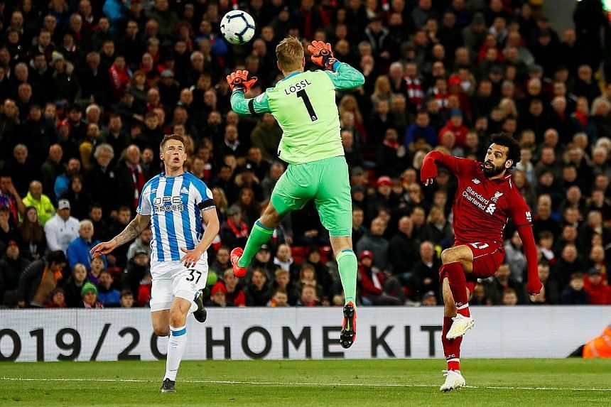 Mohamed Salah scoring Liverpool's third goal in their 5-0 rout of Huddersfield at Anfield on Friday. Salah also scored their fifth goal. PHOTO: REUTERS