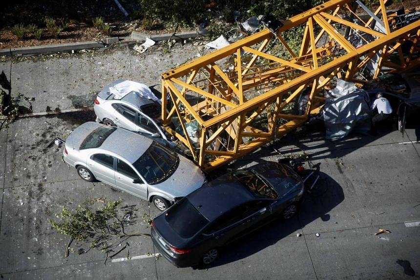 """In a statement, the fire department said the crane """"fell from the roof of a building"""" and hit six vehicles below, near the southern shore of Lake Union, which lies in the centre of the Seattle."""