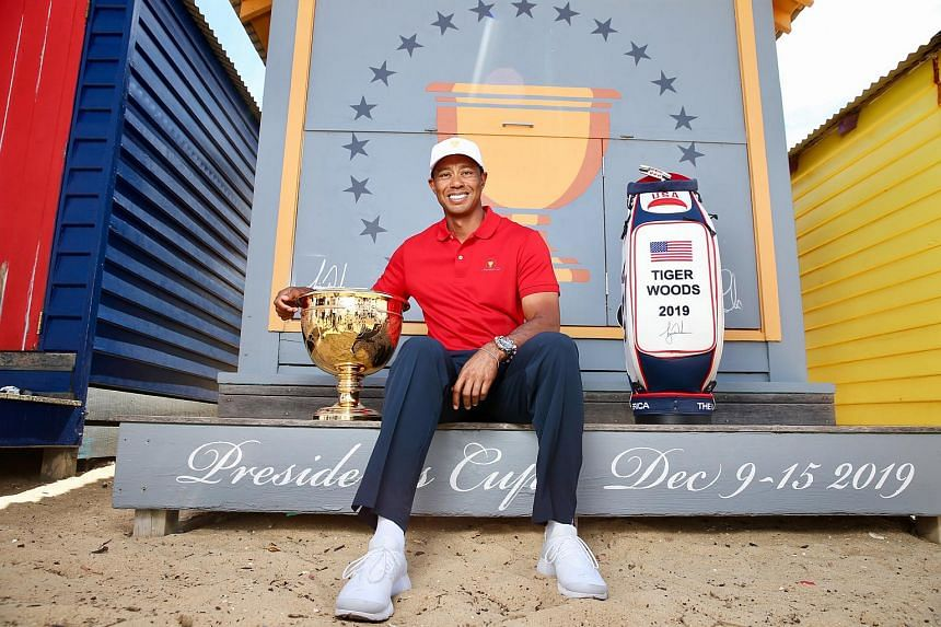 Tiger Woods, the playing captain for the US team, posing with the Presidents Cup in Melbourne.