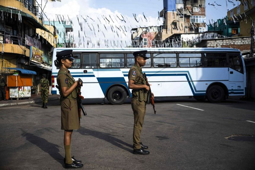 Sri Lankan police officers standing guard at a barricade near St Anthony's Church in Colombo on April 28, 2019.