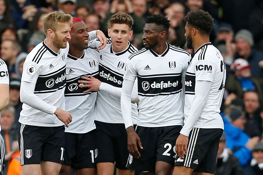 Fulham's Dutch defender Ryan Babel (second left) celebrates his goal with team mates.
