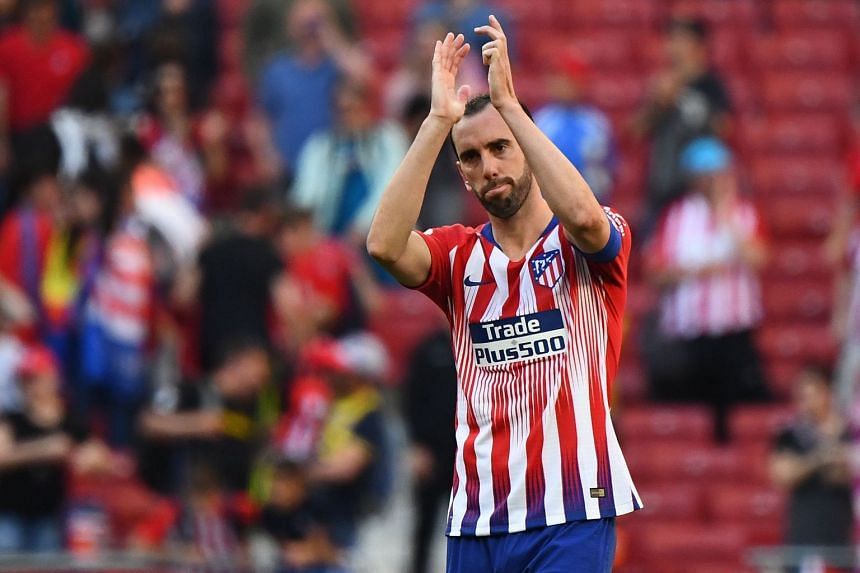 Atletico Madrid's Uruguayan defender Diego Godin acknowledges fans at the end of the match.