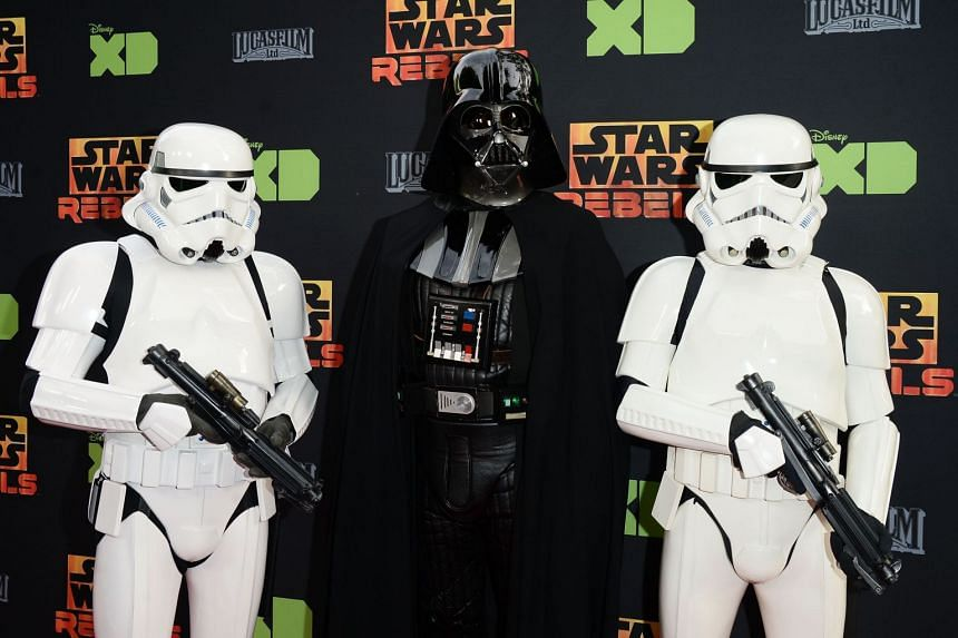 Darth Vader and two Stormtroopers at a Star Wars Rebels event at Walt Disney Studios in California.
