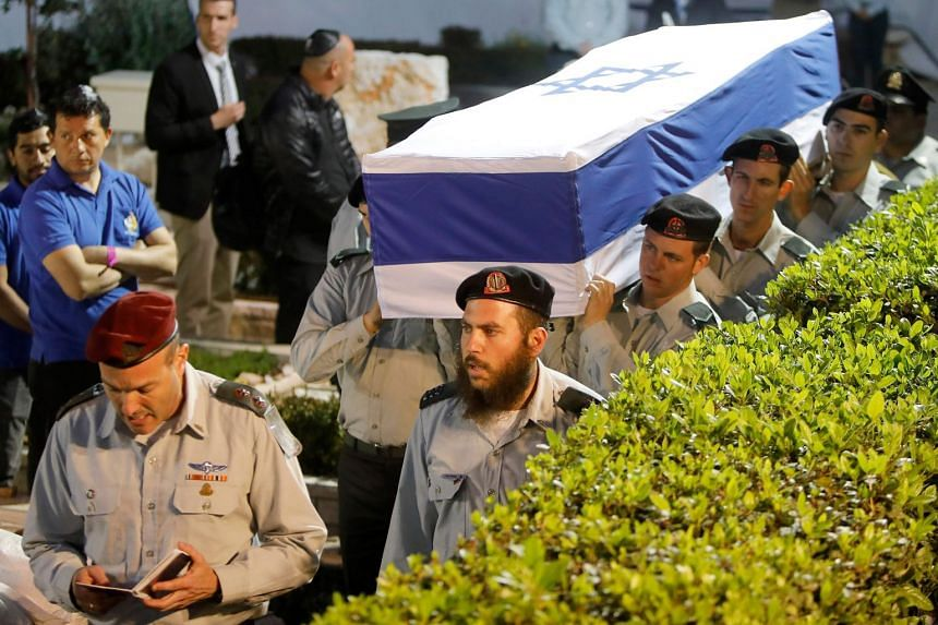 Israeli soldiers carry the coffin of Zachary Baumel during his funeral in Jerusalem in April 2019.