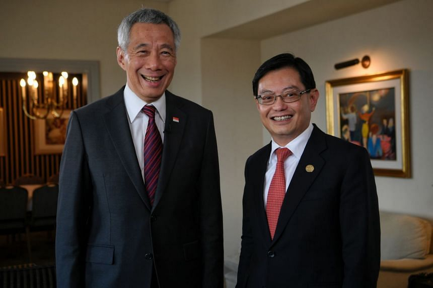 Prime Minister Lee Hsien Loong (left) and Finance Minister Heng Swee Keat at the G20 Leaders Summit in Buenos Aires, Argentina, on Dec 1, 2018.