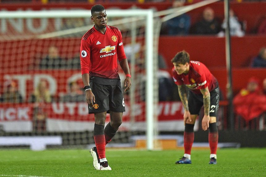 Midfielder Paul Pogba (left), defender Victor Lindelof and their Manchester United teammates could not handle Manchester City in the second half of their 2-0 Premier League derby defeat on Wednesday. There has been speculation over the future of club