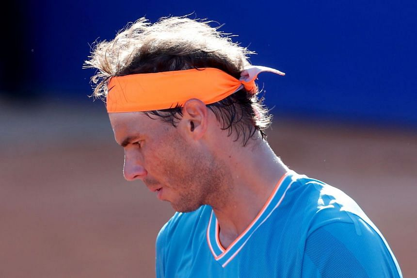 Nadal looks down during the match against Austria's Dominic Thiem.
