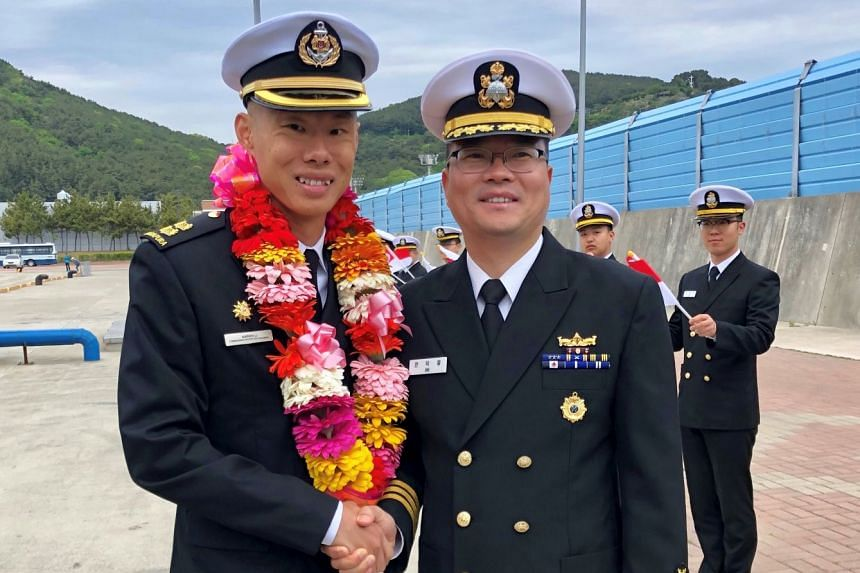 Commanding Officer of the Republic of Singapore Navy's RSS Stalwart Lieutenant Colonel Aaron Li (left), is welcomed by Commanding Officer of the Republic of Korea Navy's ROKS Jeonbuk Commander Ahn Deok-yeol, in Busan, South Korea.