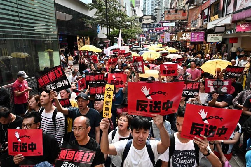 Protesters demonstrating against a controversial move by the government to allow extraditions to the Chinese mainland, on April 28, 2019.
