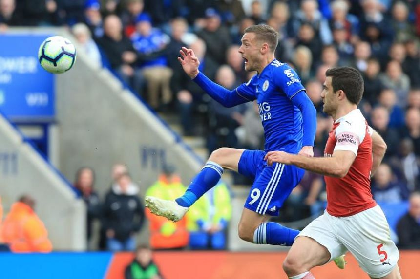 Leicester City striker Jamie Vardy (left) scoring his team's second goal against Arsenal during the EPL match on April 28, 2019.