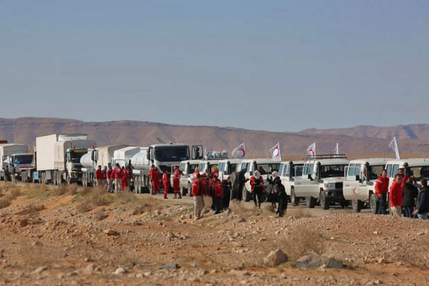 A convoy of Red Crescent vehicles arriving at the Rukban camp along Syria's border with Jordan on Feb 6, 2019. Local sources say Syrian and Russian forces have choked off supplies to the camp since mid-Feburary.