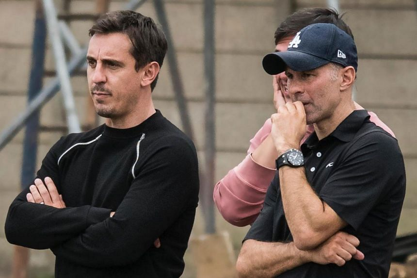 Salford City co-owners Gary Neville (left) and Ryan Giggs, along with other co-owners from their Manchester United Class of '92, are hoping to take the club up to the upper echelons of English football.