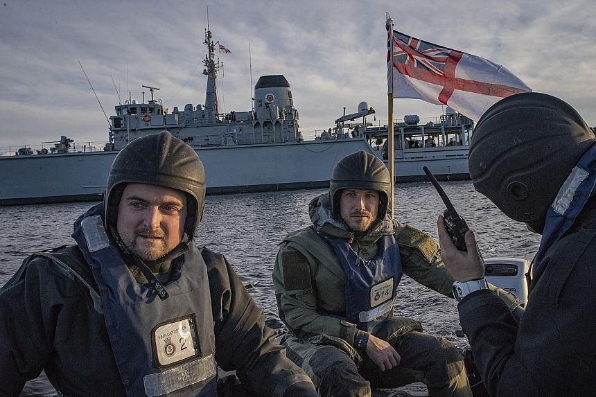 Sailors from the Royal Navy's HMS Cattistock taking part in mine-sweeping exercises in Molde, Norway, on Oct 30, 2018. As Britain spends heavily on big-ticket items like nuclear-armed submarines and aircraft carriers, its military is no longer deemed