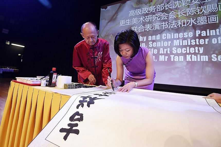 Ms Grace Chew, (above, far right), president of the International Cheongsam Association of Singapore (ICAS), leading members of her association as well as artists from Life Art Society in showcasing their outfits on stage at the Singapore Chinese Cul