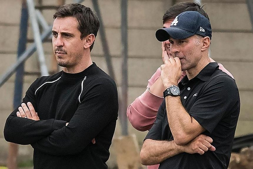 Salford City co-owners and former Manchester United stars such as Gary Neville and Ryan Giggs (with cap) have taken the club up three divisions in four seasons.