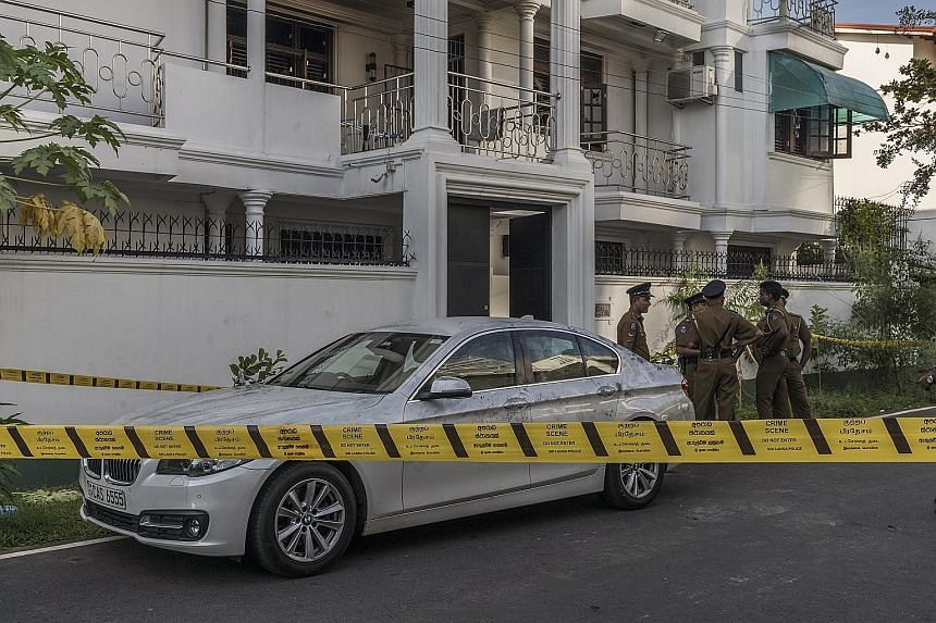 Police outside the Ibrahim mansion in Colombo, where the wife of Ilham Ibrahim, the son of one of Sri Lanka's wealthiest spice traders, set off a bomb, killing herself, her three children and three officers, last Tuesday. Mr Anders Holch Povlsen and