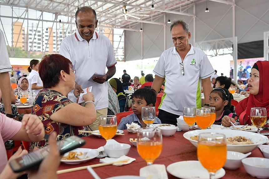 Law and Home Affairs Minister K. Shanmugam, an MP for Nee Soon GRC, giving out FairPrice vouchers at yesterday's lunch. The funds came from the surplus of about $250,000 earned by FutsalArena@Yishun.