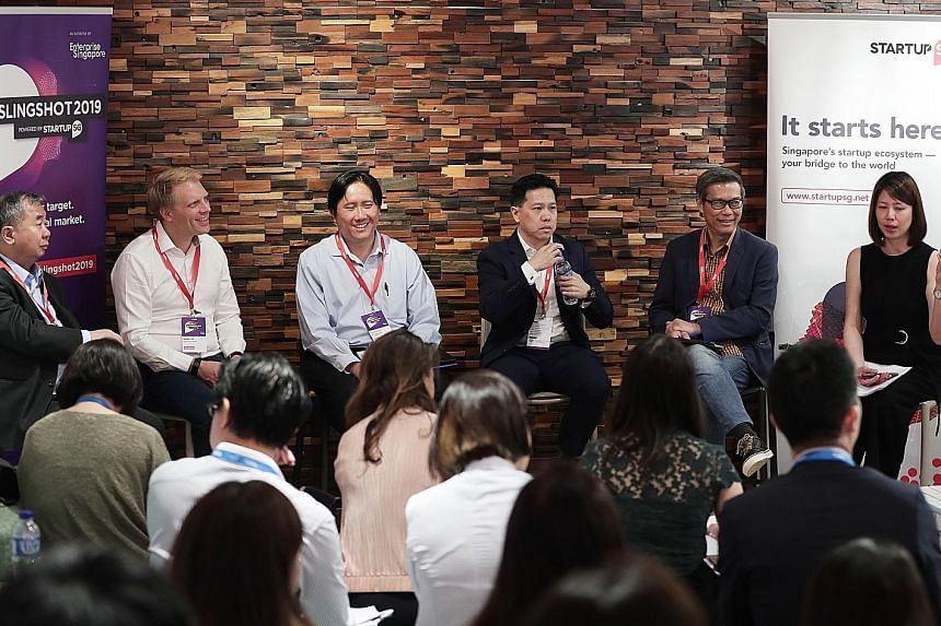 An industry panel at last Friday's media briefing comprising (from left) National University of Singapore deputy president of innovation and enterprise Freddy Boey, Antler chief executive and founder Magnus Grimeland, Enterprise Singapore assistant C